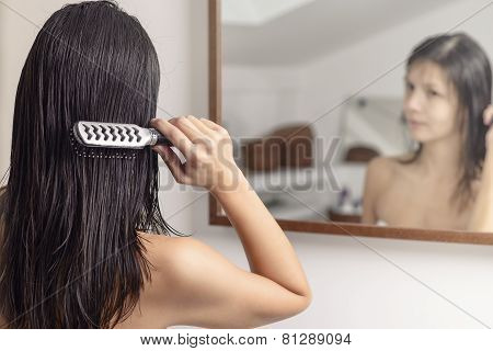 Woman Brushing Her Wet Hair