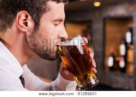 Man Drinking Beer.