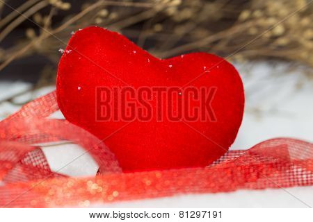 Red Plush Heart As A Symbol Of Love Valentine's Name On A Background Of Snow.