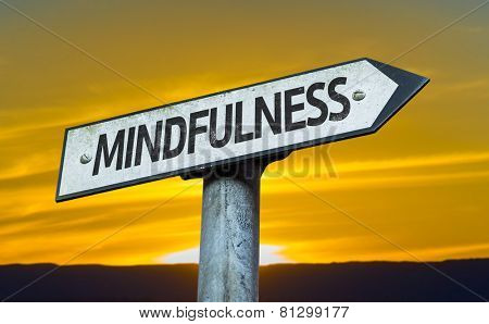 Mindfulness sign with a sunset background