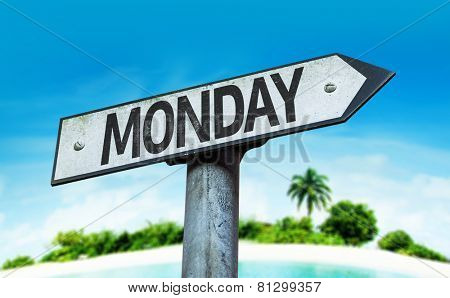 Monday sign with a beach on background
