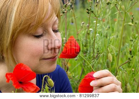 Woman With A Poppy