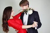picture of tango  - Young beautiful couple dancing tango with a rose - JPG