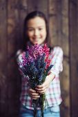 image of wildflowers  - Little girl showing bunch of fresh wildflowers - JPG