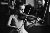 stock photo of tutu  - Little girl in tutu playing the violin - JPG
