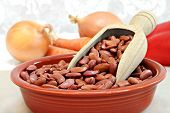 picture of phaseolus  - Raw kidney beans with a wooden scoop in a bowl selective focus macro with copy space - JPG