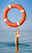 stock photo of dangerous situation  - Lifebuoy for man in danger - JPG