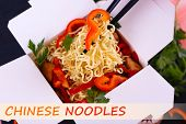 image of takeaway  - Chinese noodles with vegetables in takeaway box and space for your text - JPG