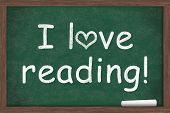 pic of chalkboard  - I love reading I love reading written on a chalkboard with a piece of white chalk - JPG