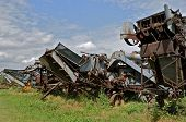 foto of lineup  - Lineup old vintage threshing machines display the feeders of each item of equipment - JPG