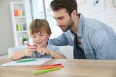 picture of daddy  - Daddy with little boy making drawings at home - JPG