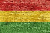 stock photo of reggae  - Colors of reggae music painted over white brick wall - JPG