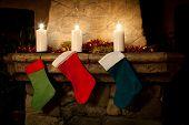 image of chimney  - Christmas stocking on fireplace background - JPG