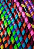 foto of hula hoop  - Colorful wrapped hula hoops on display for sale form a rainbow of color - JPG