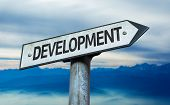stock photo of sustainable development  - Development sign with sky background - JPG