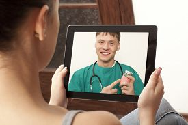 pic of chat  - Woman having video chat with doctor on laptop at home - JPG