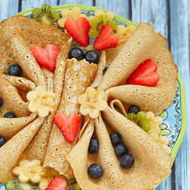 stock photo of crepes  - Funny butterfly shaped crepes with berries for kids - JPG