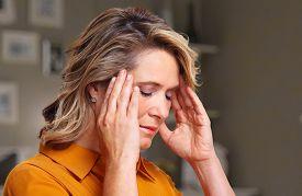 picture of depressed  - Woman having headache migraine - JPG