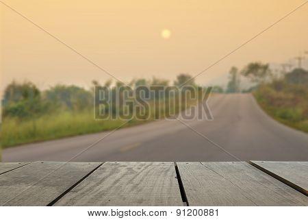 Defocus And Blur Image Of Terrace Wood And Asphalt Road Through