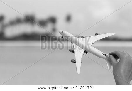 Small white miniature of an airplane. Black white foto.