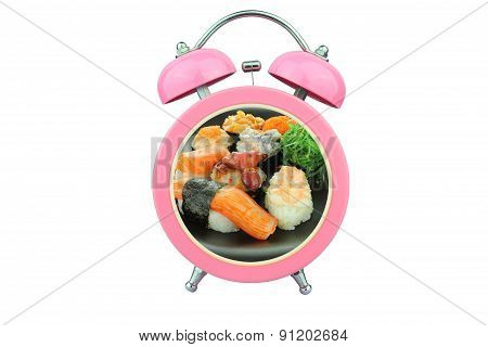 Conceptual Art : Sushi Time : Sushi Within Pink Alarm Clock Isolated On White Background
