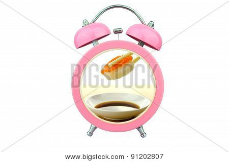 Conceptual Art : Sushi Time : Holding Salmon Sushi And Sauce Within Pink Alarm Clock Isolated On Whi