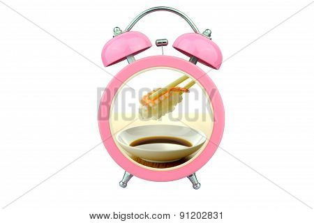 Conceptual Art : Sushi Time : Holding Shrimp Sushi And Sauce Within Pink Alarm Clock Isolated On Whi