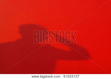 Shadow Proud Saluting Male Army Soldier On Red Background