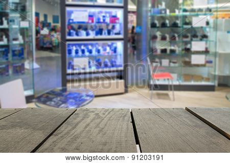 Defocus And Blur Image Of Terrace Wood And Camera Shop For Backg