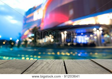 Blur Image Of Terrace Wood And Swimming Pool In Modern hotel