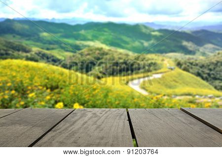 Blur Image Of Terrace Wood And Sunflower Field