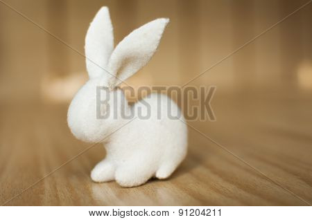 White Rabbit on wooden table