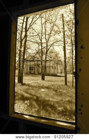 Open window view of an old house(sepia)