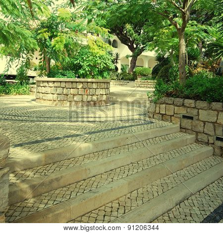 Garden View With Trees And Cobblestone Patio, Portugal
