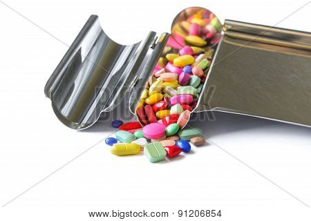 Colorful medicine on the drug counting tray.