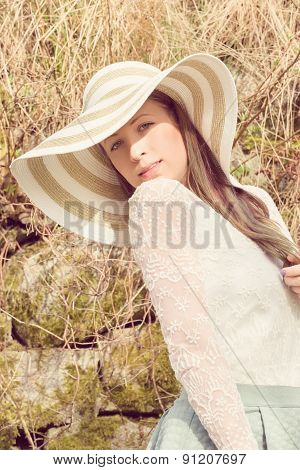 Cheerful Fashionable Woman In Stylish Hat And Frock Posing