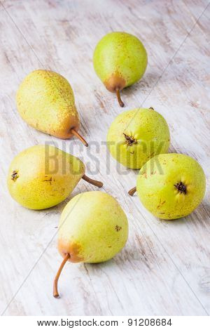 Pears On A Wooden Table.