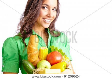 Young woman with sack of healthy products looking at camera