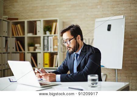 Male employee working in office