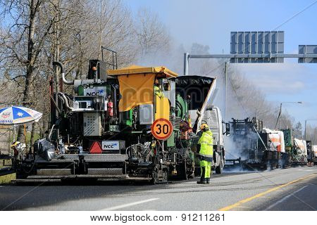 Machine Laying Asphalt Concrete At Road Works