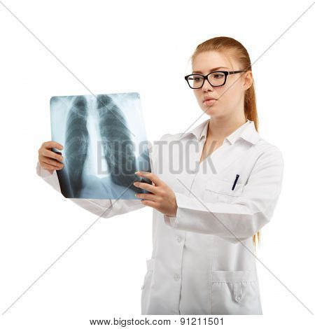Young Beautiful Woman Doctor Inspects An X-ray Of The Chest And Spine