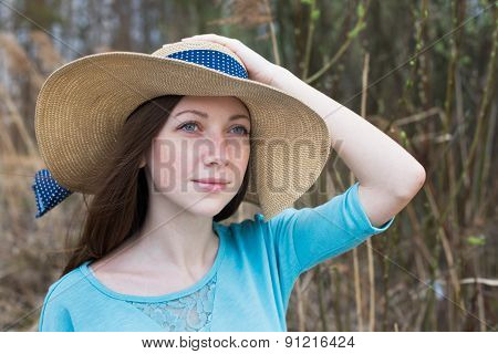 Freckled Girl In Hat In Windy Weather