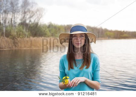Freckled Girl In Hat And With Bouquet