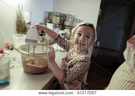 Little Girl Mixing Dough For A Birthday Cake