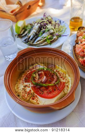 Grilled feta cheese, traditional Greek dish