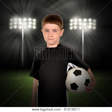 Soccer Boy Holding Ball In Stadium