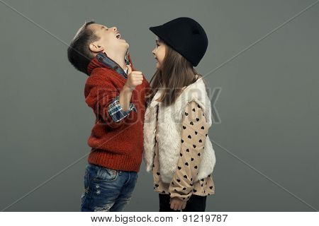 A Portrait Of A Laughing Girl And A Smiling Boy. Autumn Style