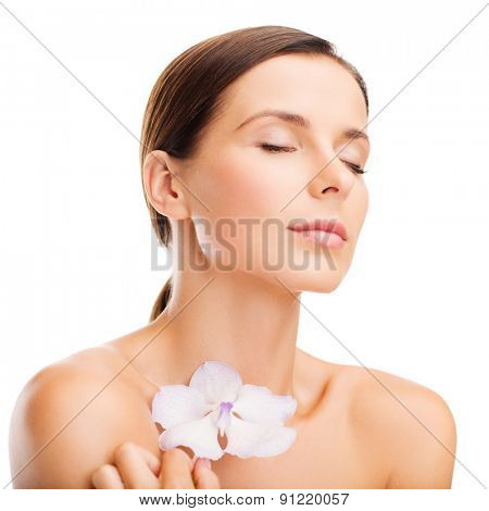 health and beauty concept - relaxed woman with orhid flower