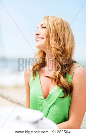 summer holidays and vacation - girl in cafe on the beach