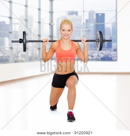 fitness, sport, weightlifting and people concept - sporty woman exercising with barbell over gym background